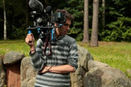 Producer Director Guy Natanel holding cameraFilm and Video Production