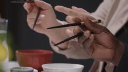 Hands holding Chopsticks BBC Ideas Video Production
